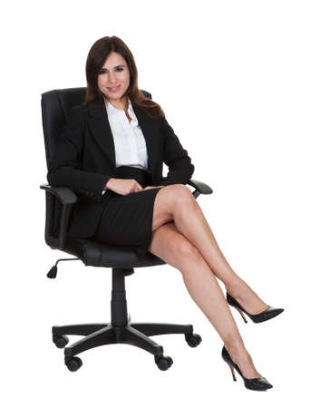 legs crossed: Portrait Of Businesswoman Isolated On White Background