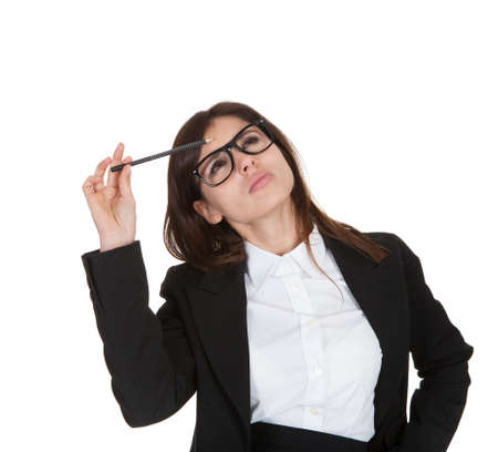 Businesswoman Gesturing With Pencil On White Background photo