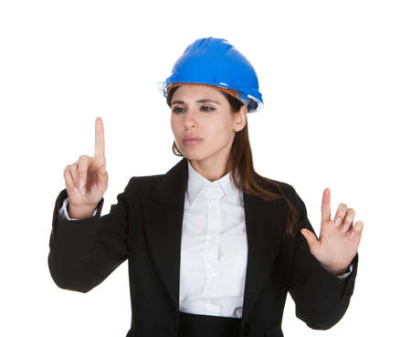 Female Architect Touching The Screen With Her Finger On White Background photo