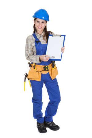 workmen: Female Worker Showing Blank Clipboard On White Background