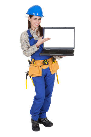 Portrait Of Female Worker Pointing On Laptop photo