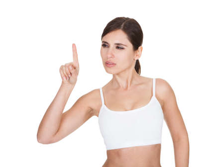 Portrait Of Healthy Woman The Screen With Her Finger On White Background photo