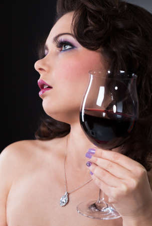 Portrait Of Beautiful Young Woman Holding Wine Glass photo