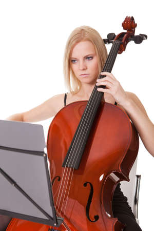 Beautiful young woman playing cello. Isolated on white Stock Photo - 18497193