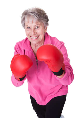 Portrait Of Senior Female Boxer Isolated On White Background photo