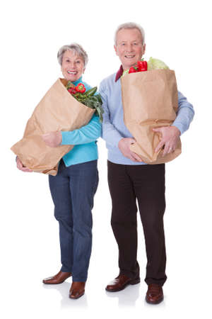 Portrait Of Happy Senior Couple Shopping Fresh Vegetables Stock Photo - 18497256