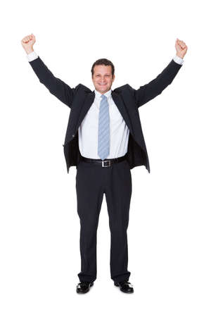 Portrait of excited businessman. Isolated on white background photo