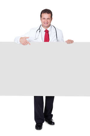Confident doctor presenting empty banner. Isolated on white background Stock Photo
