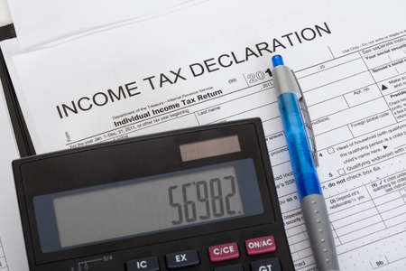 Closeup of income tax declaration, calculator and pen Stock Photo - 18461931