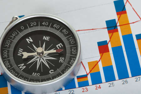 Close-up on compass on top of business data papers Stock Photo - 18461920