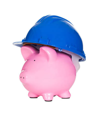 resources management: Piggybank wearing construction helmet. Isolated on white Stock Photo