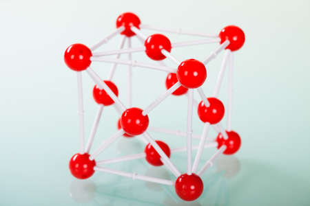 preservative: Model of copper molecular structure on green reflective background Stock Photo