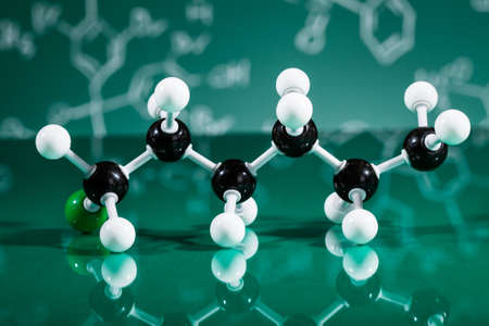 reaction: Model of molecular structure on green reflective background