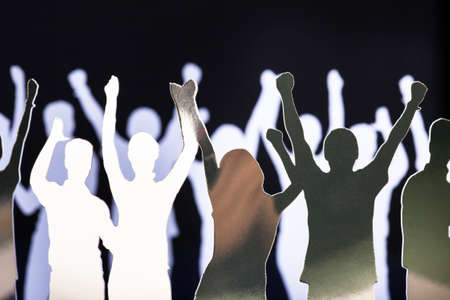 connecting: Silhouettes of exited people standing in circle
