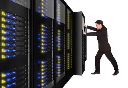 Businessman pushing server rack in place. Isolated on white photo