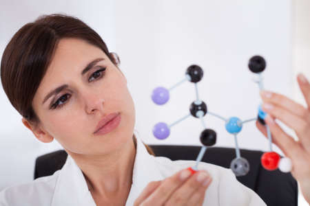 scientist woman: Female Scientist Concentrating On Dna Molecular Structure In Laboratory Stock Photo