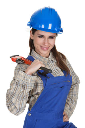 Female Worker Holding Wrench And Toolbox On White Background photo