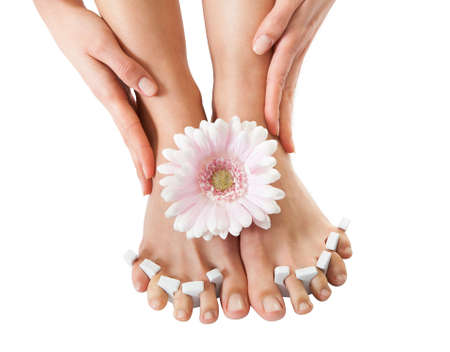chiropody: Close-up Of Womans Feet Getting Pedicure Treatment Stock Photo