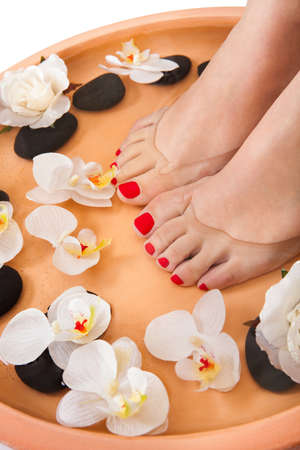 to soak: Close-up Of Female Feet Getting Spa Aroma Therapy