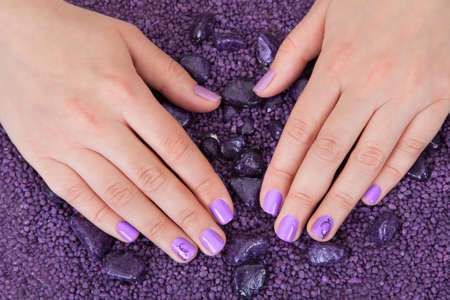 Human Fingers With Beautiful Manicure In Purple Color photo