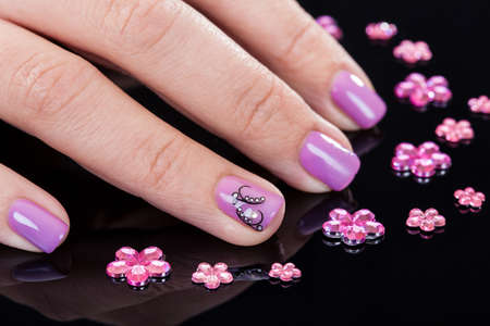 Close-up Of Beautiful Manicured Fingernails And Rhinestones photo