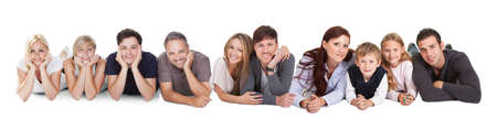 Happy young people lying on white background photo