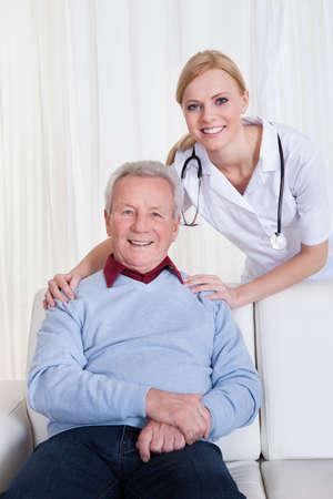 hospital: Portrait Of Happy Doctor And Patient; Indoor Stock Photo