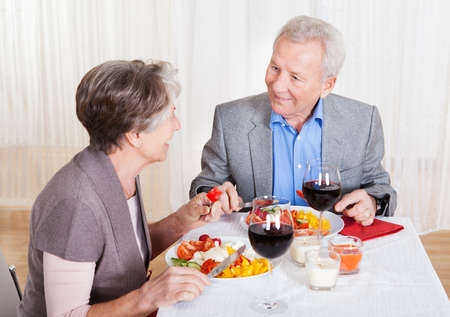 Portrait Of Senior Couple With Wine Glasses Sitting At A Restaurant Stock Photo - 18621281