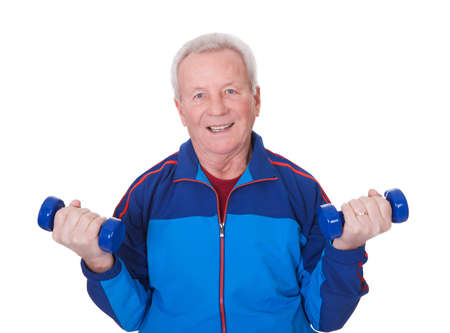 man lifting weights: Portrait Of A Senior Man Exercising On White Background Stock Photo