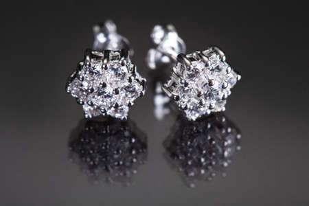 Close-up Of Diamond Earrings Over Black Background