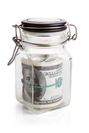 Us Dollar Notes Stored In Jar Over White Background photo