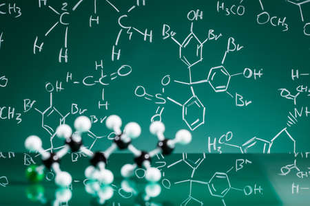 chemistry formula: Model of molecular structure on green reflective background