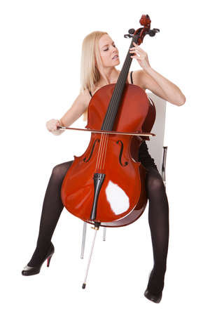 Beautiful young woman playing cello. Isolated on white photo