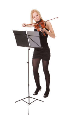 Beautiful young woman playing violin. Isolated on white photo