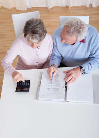 Photo of Senior Couple Calculating Budget At Home photo