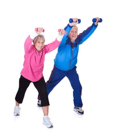 lifting: Portrait Of A Senior Couple Exercising On White Background