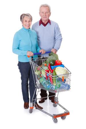 Portrait Of Happy Senior Couple Shopping Fresh Vegetables Stock Photo - 18882072