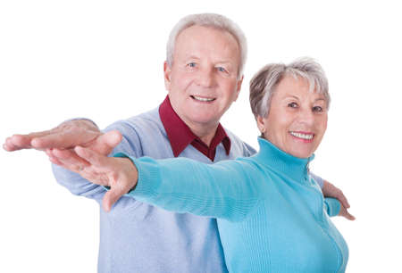 arm extended: Portrait Of Happy Senior Couple Isolated Over White Background