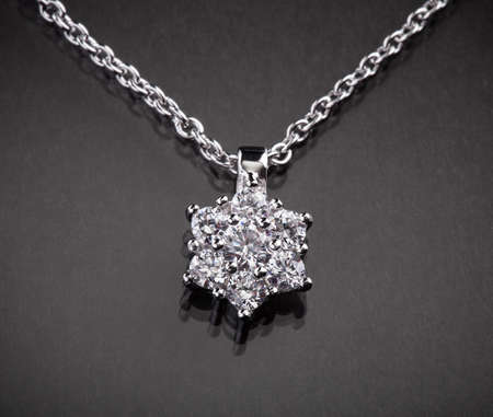 Close-up Of Diamond Necklace Over Black Background photo