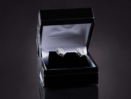 Close-up Of Diamond Earrings In The Case photo