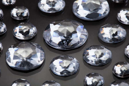karat: Close-up Of Diamonds Isolated Over Gray Background