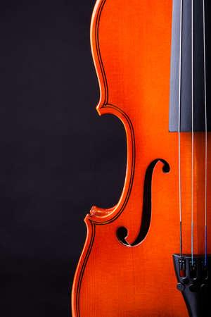 of mozart: Close-up Of Vintage Violin Over Black Background Stock Photo