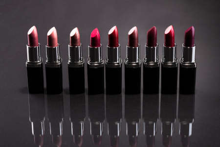 Lipsticks In A Row Isolated Over Gray Background photo