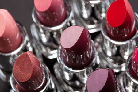 lipstick tube: Lipsticks In A Row Isolated Over Gray Background Stock Photo