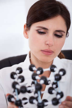 Female Scientist Concentrating On Molecular Structure In Laboratory photo