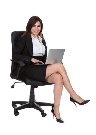 Happy Young Businesswoman Using Laptop Over White Background photo