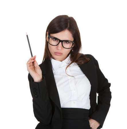 strict: Businesswoman Gesturing With Pencil On White Background