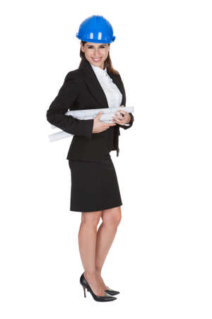 Portrait Of Female Architect Holding Blueprints One White Background photo