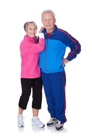 Portrait Of A Senior Couple Exercising On White Background photo