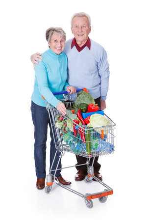grocery basket: Portrait Of Happy Senior Couple Shopping Fresh Vegetables